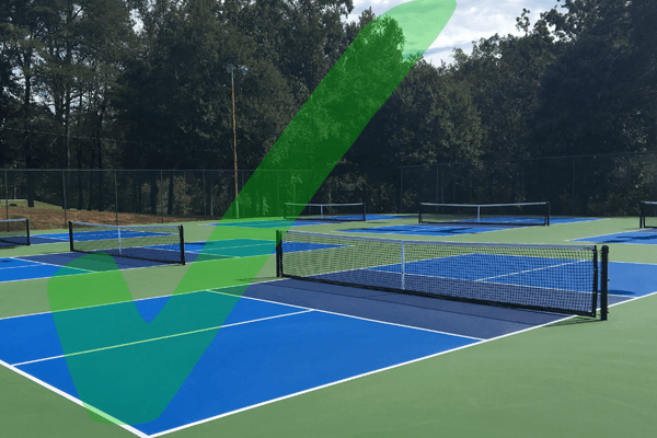 photo of pickleball court with a graphic checkmark over it