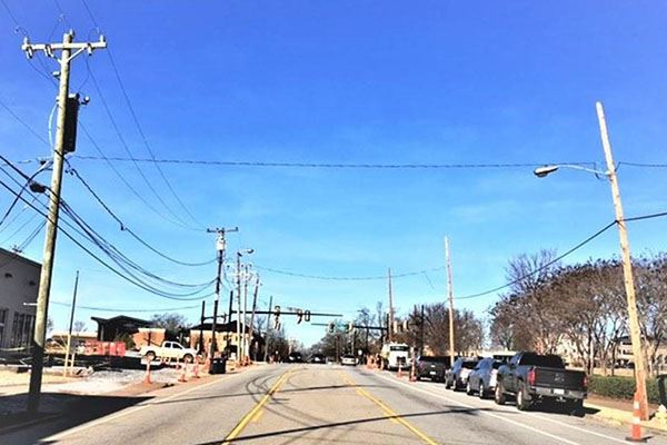 photo of West Washington Street showing numerous overhead power and communication lines
