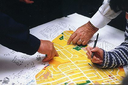 photo of people's hands on planning documents